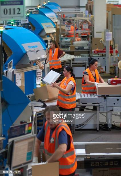 Amazon employees at work in the packaging department of the Amazon logistics centre in Werne Germany 12 November 2015 The online shop is introducing...