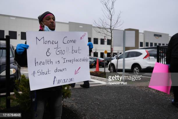 Amazon employees hold a protest and walkout over conditions at the company's Staten Island distribution facility on March 30, 2020 in New York City....