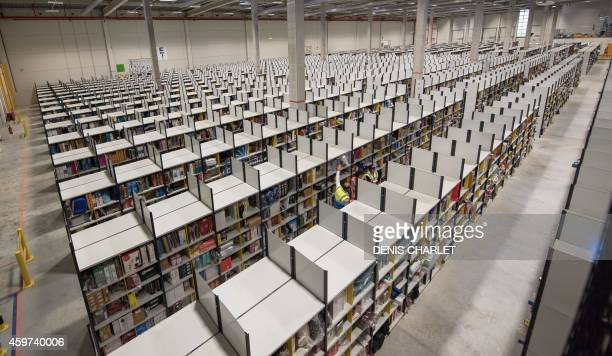 PAYSANT Amazon employees work in a logistic site of the US online sales giant on November 26 2014 in LauwinPlanque northern France 1500 employees...