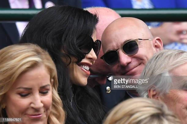 Amazon Founder and CEO Jeff Bezos and his partner US new anchor Lauren Sanchez watch Switzerland's Roger Federer playing Serbia's Novak Djokovic...