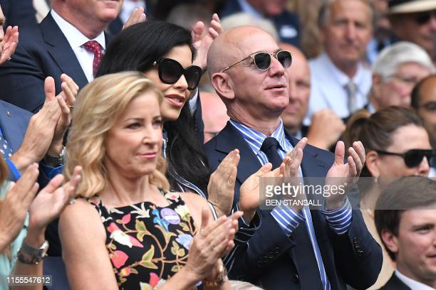 Amazon Founder and CEO Jeff Bezos and his partner US news anchor Lauren Sanchez stand as Switzerland's Roger Federer and Serbia's Novak Djokovic...