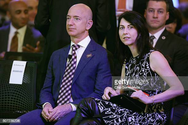 Amazon founder and Washington Post owner Jeff Bezos and his wife MacKenzie Bezos participate in the opening ceremony of the newspaper's new location...
