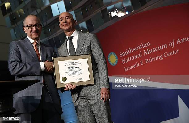 Amazon Founder and Washington Post owner Jeff Bezos is presented with the James Smithson Bicentennial Medal by Smithsonian Secretary David Skorton...