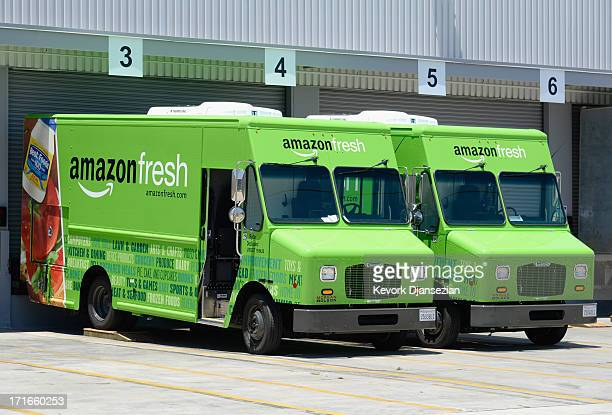 Amazon Fresh trucks sit parked at a warehouse on June 27 2013 in Inglewood California Amazon began groceries and fresh produce delivery on a trial...