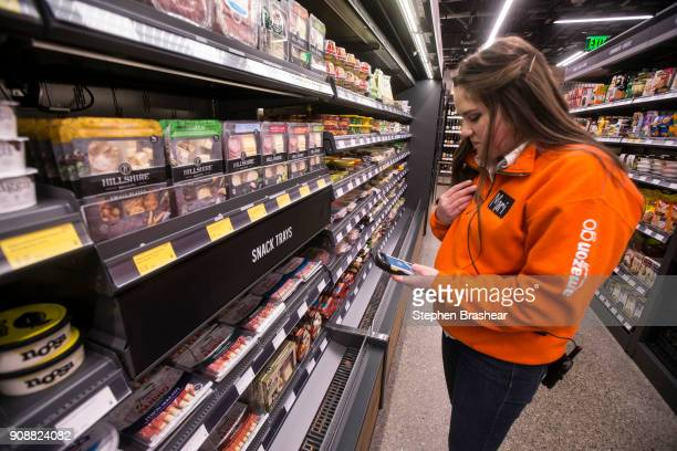 Amazon Go employee Mari Avellaneda stocks shelves using a mobile device at the Amazon Go store on January 22 2018 in Seattle Washington After more...