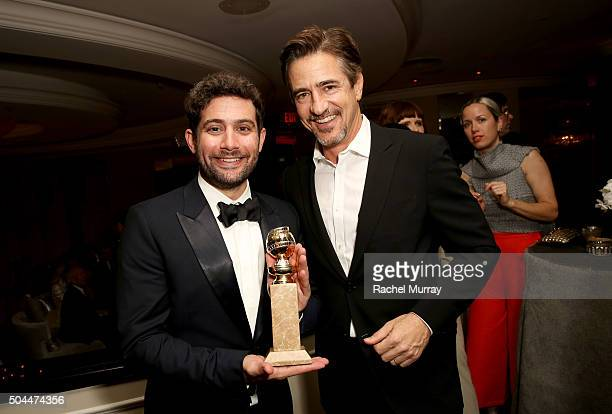 Amazon Head of HalfHour Series Joe Louis and actor Dermot Mulroney pose with a Golden Globe Award during Amazon's Golden Globe Awards Celebration at...