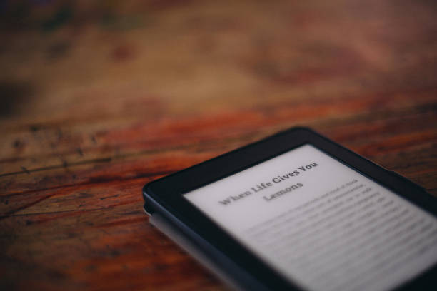 amazon kindle ereader laying on a wooden surface picture id1202535978?k=6&m=1202535978&s=612x612&w=0&h= 17TxHo3xJ 0 AH8fGlECfEOYO9uzY d55B5Nr 3yM=