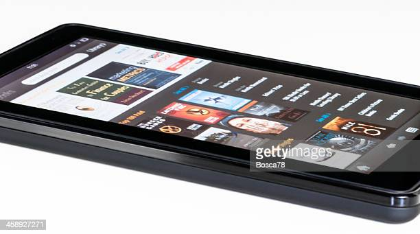 amazon kindle fire tablet isolated on white - screen saver stock photos and pictures