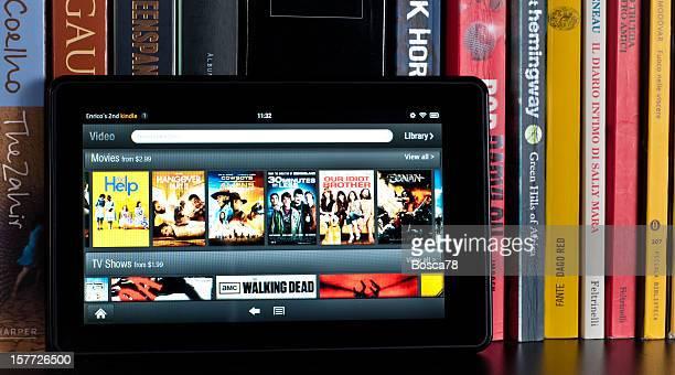 Amazon Kindle Fire tablet on a book shelf