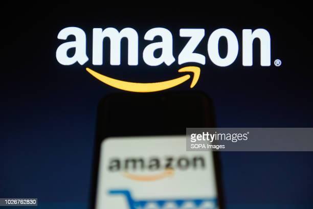 Amazon logo is seen on a mobile phone Amazon reached $1 trillion market capital