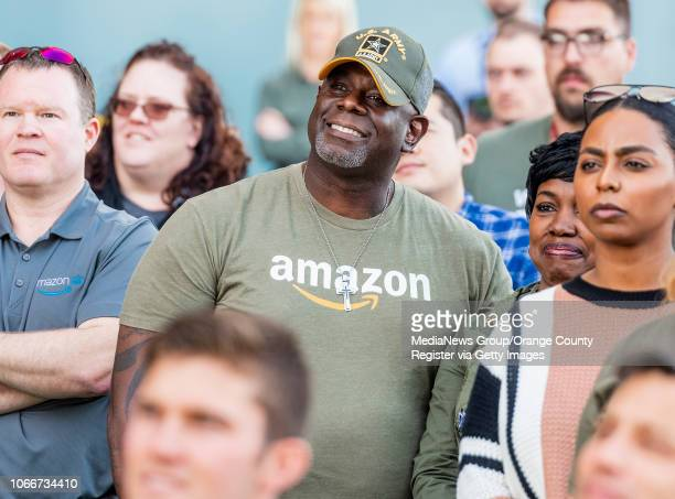 Amazon military veteran employees and their spouses listen to Jeff Bezos founder and CEO of Amazon speak after he made a surprise appearance during a...