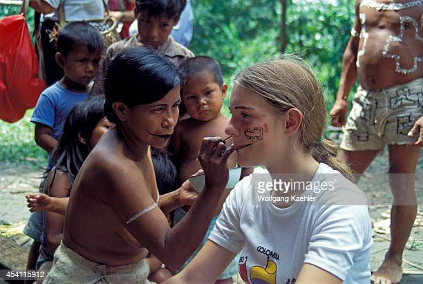 Amazon Peru Bora Indians With Girl Tourist Having Face Painted With Traditional Plant Dyes
