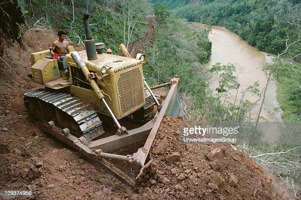 Amazon Peru Satipo Puerto Prado Road A bulldozer scraping the bed of an eastwest running road connecting Satipo to Puerto Prado on the humid eastern...
