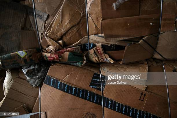 Amazon Prime boxes are seen in a bundle of recycled cardboard at Recology's Recylce Central on January 4 2018 in San Francisco California Recycle...