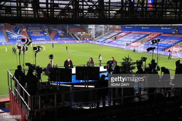 Amazon Prime commentators build up the game from their studio ahead of the English Premier League football match between Crystal Palace and Leicester...