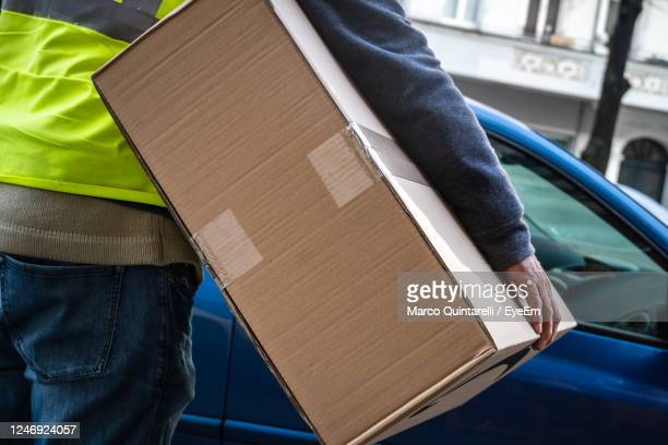 amazon prime delivery man during a work shift. amazon is an electronic online commerce company - amazon prime stock pictures, royalty-free photos & images