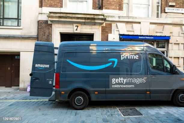 amazon prime delivery van on london city street - amazon prime stock pictures, royalty-free photos & images