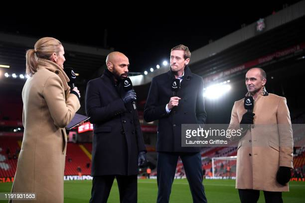 Amazon Prime TV presenters Gabby Logan, Thierry Henry, Peter Crouch and Roberto Martinez speak prior to the Premier League match between Liverpool FC...