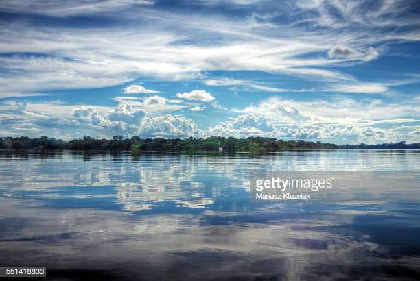 Amazon river clouds mirror reflection on calm day