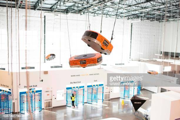 Amazon Robotics works signed by the entire staff on the opening day of the Kent Washington Fulfillment Center in March of 2016 hangs over the...