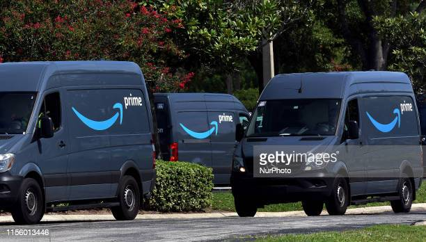 Amazon vans head to a distribution center to pick up packages for delivery on Amazon Prime Day July 16 in Orlando Florida