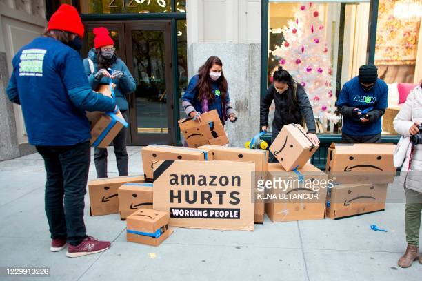 Amazon workers and community allies demonstrate during a protest organized by New York Communities for Change and Make the Road New York in front of...
