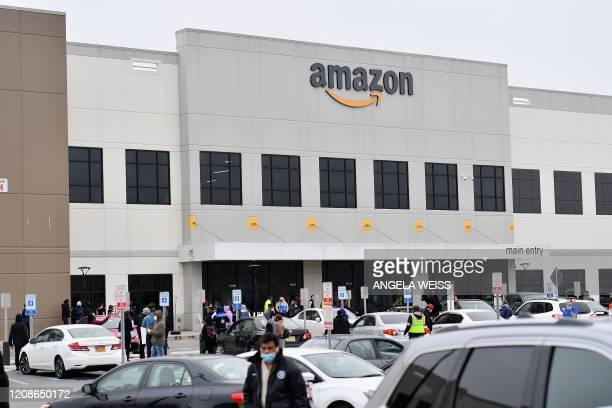 Amazon workers at Amazon's Staten Island warehouse strike in demand that the facility be shut down and cleaned after one staffer tested positive for...