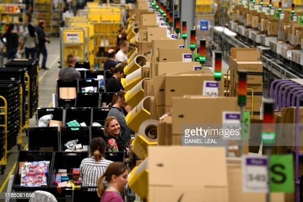 Amazon workers sort and pack items at the Amazon Fulfilment Centre in Peterborough east England on November 27 as preparations are underway for the...