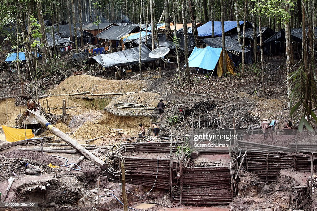 Gold mine with tents in background