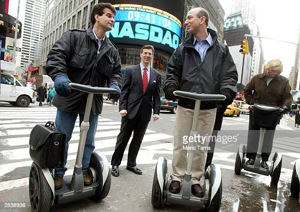 Amazoncom CEO Jeff Bezos stands on a Segway with Segway inventor Dean Kamen and NASDAQ Vice Chairman David Weild after opening the NASDAQ Stock...
