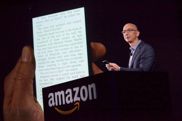Amazon.com founder and CEO Jeff Bezos demonstrates the company's first smartphone, the Fire Phone, on June 18, 2014 in Seattle, Washington. The...