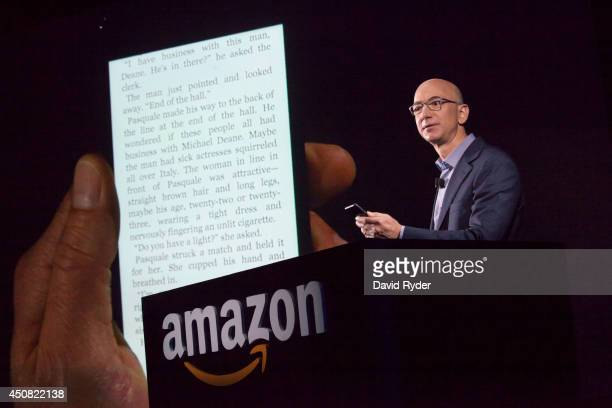 Amazoncom founder and CEO Jeff Bezos demonstrates the company's first smartphone the Fire Phone on June 18 2014 in Seattle Washington The...