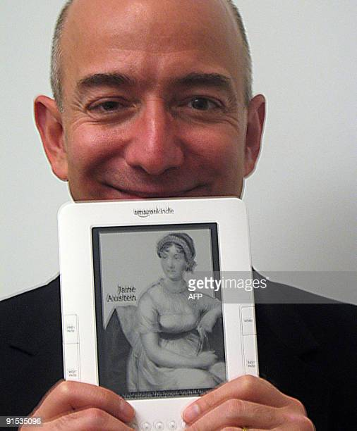 Amazoncom founder and chief executive Jeff Bezos unveils an international Kindle electronic book reader on October 6 2009 in San Francisco designed...