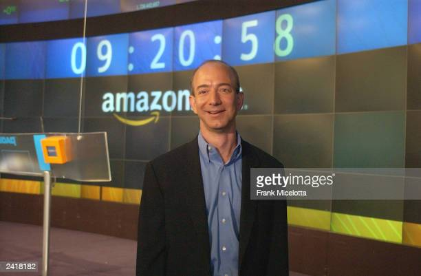 Amazoncom Founder CEO Jeff Bezos poses for a photo before opening The NASDAQ Stock Market at the MarketSite Studio in Times Square August 22 2003 in...