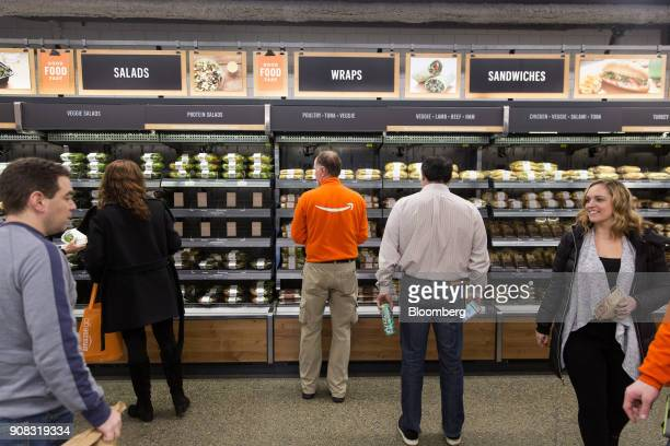 Amazoncom Inc employees shop at the Amazon Go store in Seattle Washington US on Wednesday Jan 17 2018 After more than a year of testing with an...