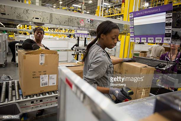 Amazoncom Inc employees unpack boxes inside an Amazoncom Inc fulfillment center on Cyber Monday in Robbinsville New Jersey US on Monday Nov 30 2015...