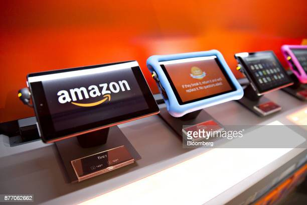 Amazoncom Inc Fire 7 tablet computers sit on display at an Amazon PopUp store inside the Lakeview Whole Foods Market Inc in Chicago Illinois US on...