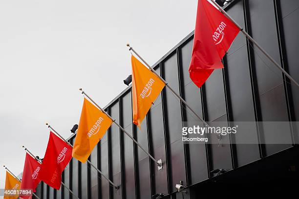 Amazoncom Inc flags fly before the start of an event at Fremont Studios in Seattle Washington US on Wednesday June 18 2014 Amazoncom Inc Chief...