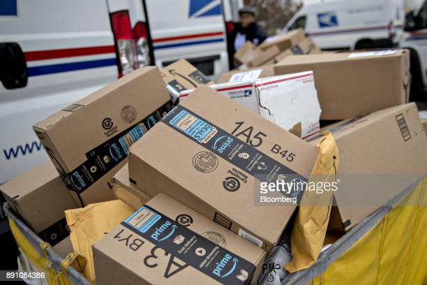 Amazoncom Inc packages sit in a bin before being placed on a delivery vehicle at the United States Postal Service Joseph Curseen Jr and Thomas Morris...