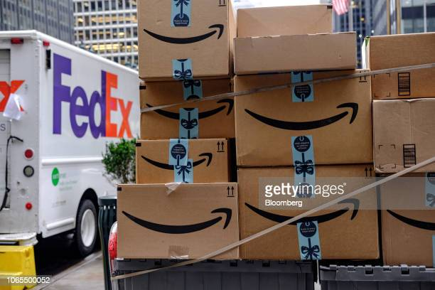 Amazoncom Inc packages sit in front of a FedEx Corp delivery truck in New York US on Monday Nov 26 2018 Americans spent $506 billion online this...