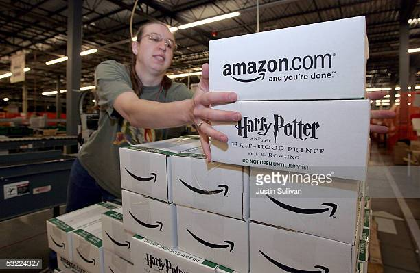 Amazoncom worker Jennifer Bladow moves prepackaged copies of the new Harry Potter and the Half Blood Prince by author J K Rowling on a conveyor belt...