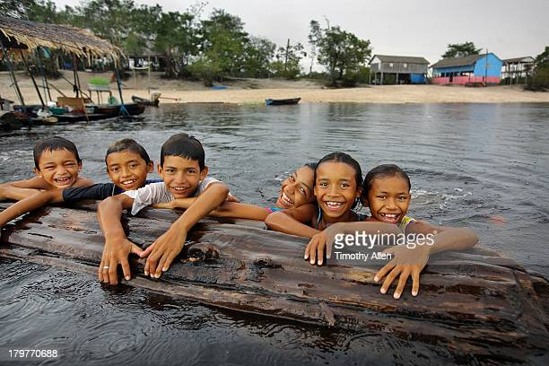 Amazonian children play in Rio Negro river