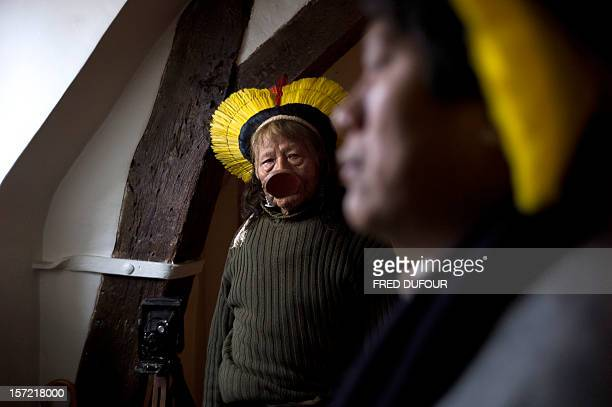 Amazonian Indian tribe Kayapo chief Raoni Metuktire poses before a press conference with French environmental activist Nicolas Hulot on November 30...
