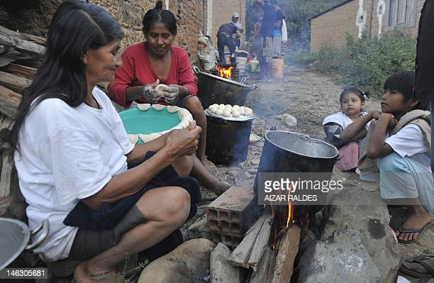 Amazonian indigenous women make bread in an encampment set in Chojna 120 km from La Paz on June 13 2012 Amazonian natives are marching since 44 days...