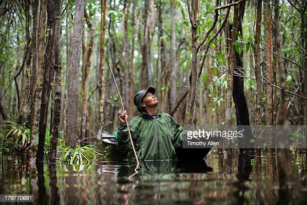 Amazonian woman hunts in Rio Negro River forest