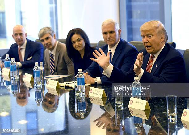 Amazon's chief Jeff Bezos Larry Page of Alphabet Facebook COO Sheryl Sandberg Vice Presidentelect Mike Pence and Presidentelect Donald Trump at Trump...