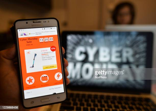 Amazon's Cyber Monday online store offers displayed on a mobile phone. Cyber Monday is a marketing term for the Monday after the Thanksgiving...