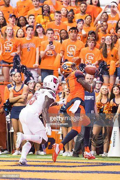 Amba EttaTawo of the Syracuse Orange pulls in a touchdown reception during the second quarter against the Louisville Cardinals on September 9 2016 at...