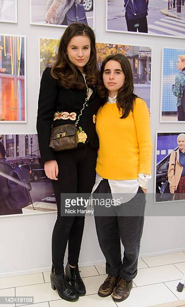 Amba Jackson and Assisi Jackson attend the Club Monaco Tommy Ton exhibition at Harvey Nichols on April 4 2012 in London England
