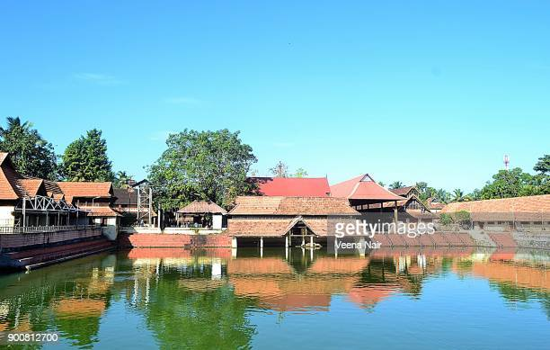 ambalappuzha sri krishna temple and the temple pond-alleppey-kerala - krishna stock photos and pictures